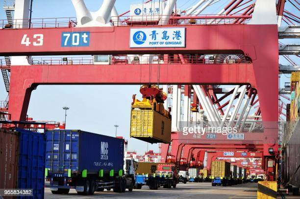 Containers are transferred at the port in Qingdao in China's eastern Shandong province on May 8 2018 China's surplus with the United States widened...