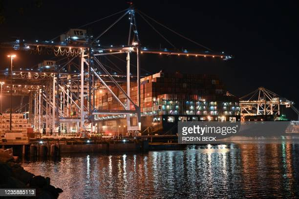 Containers are unloaded from ships at the Port of Los Angeles, in Los Angeles, California, October 14, 2021. - The Port of Los Angeles and its...