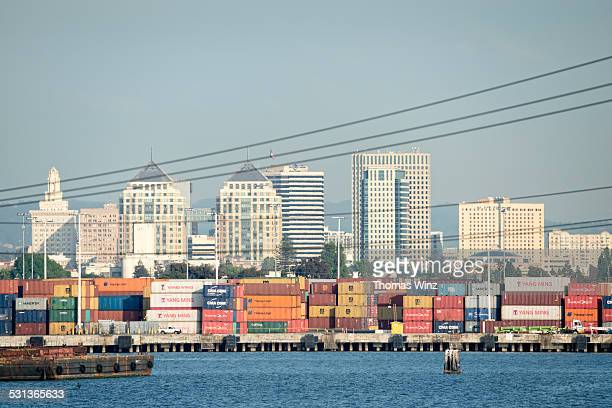 containers at oakland harbor - oakland california skyline stock pictures, royalty-free photos & images