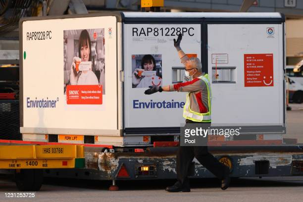 Containers carrying Sinovac Biotech coronavirus disease vaccines are unloaded from a Cathay Pacific Airways aircraft at the Hong Kong International...