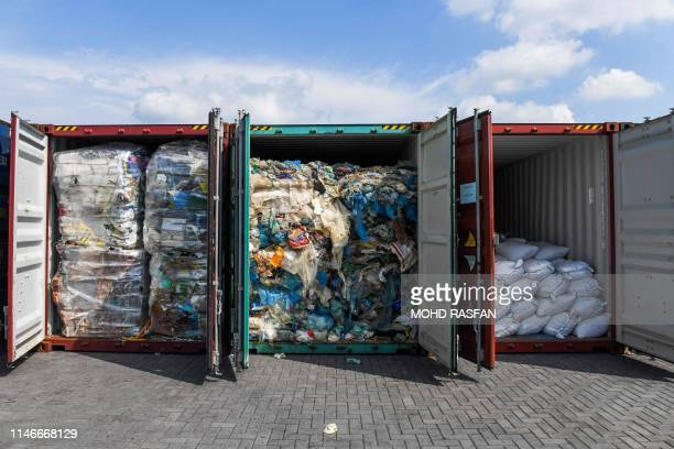 Containers filled with plastic waste shipment are seen on May 28 2019 during an inspection before sending back to the country of origins in Port...