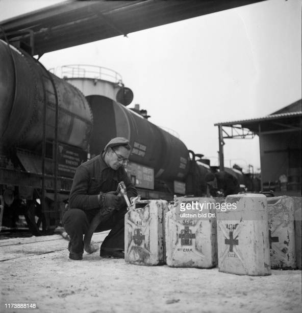 Containers for the Red Cross Petrol importation and storage Basle rhine port around 1946