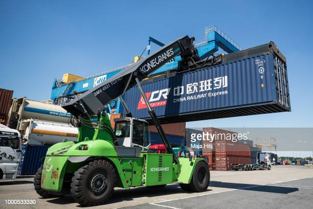 Containers from China are taken between terminals in the Duisburg port on July 16 2018 in Duisburg Germany Approximately 25 trains a week use the...