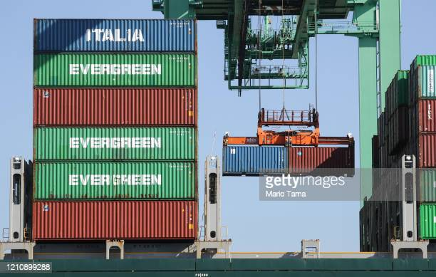 Containers from the container ship Ever Legacy are offloaded after arriving from Taipei at the Port of Los Angeles which is the nation's busiest...