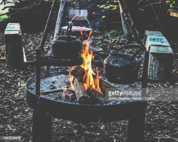 Containers Hanging On Fire Pit