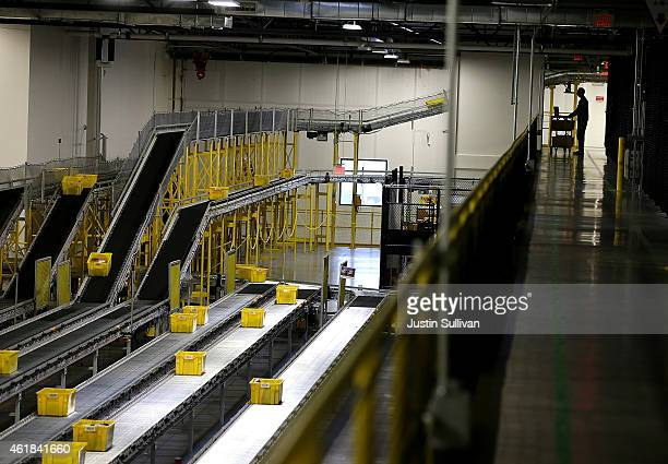 Containers move along conveyor belts at an Amazon fulfillment center on January 20 2015 in Tracy California Amazon officially opened its new 12...