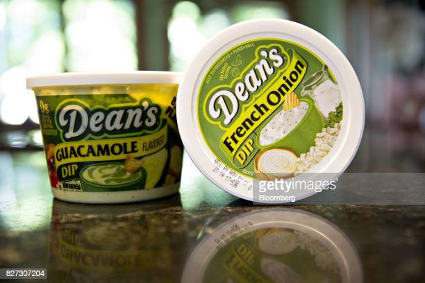 Containers of Dean Foods Co Dean's brand guacamole dip and french onion dip are displayed for a photograph in Tiskilwa Illinois US on Thursday Aug 3...