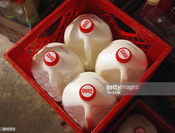 Containers of milk are seen in the cooler of a convenience store April 12 2004 in Chicago Illinois Agriculture experts say consumers could pay as...