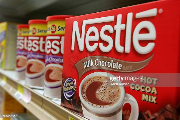 Containers of Nestle hot chocolate mix are seen on a store shelf February 23 2006 in San Francisco California Profit for Nestle the world's biggest...