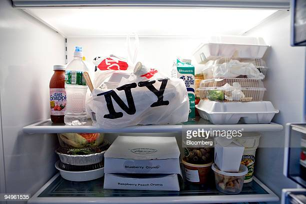 Containers of take-out food fill refrigerator shelves inside the apartment of Marc Dreier, founder of the law firm Dreier LLP sentenced to 20 years...