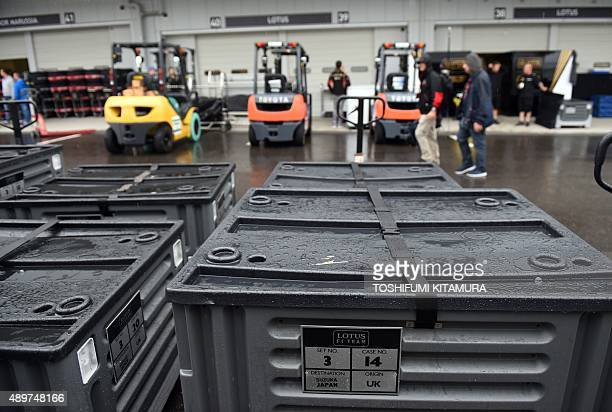 Containers of the Lotus F1 team are placed on the paddock ahead of the Formula One Japanese Grand Prix at the Suzuka circuit on September 24, 2015....