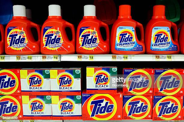 Containers of Tide detergent made by Procter Gamble Co sit on a market shelf on Tuesday January 30 in New York Procter Gamble Co and ColgatePalmolive...