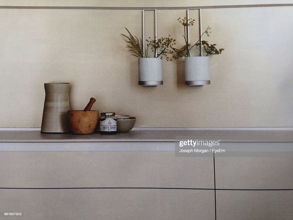 Containers On Kitchen Counter Against Wall