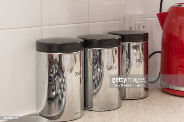 containers on kitchen counter - red kettle stock photos and pictures