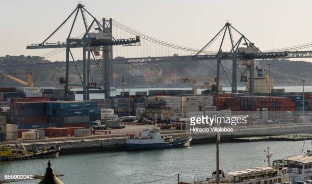 Containers property of NileDutch Maersk Hamburg Sud and APL are seen at Alcantara Dock in Lisbon harbor on September 28 2017 in Lisbon Portugal...