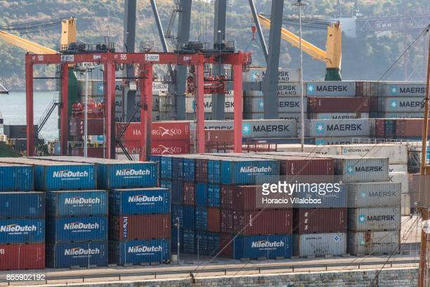 Containers property of NileDutch Maersk Hamburg Sud and Safmarine are seen at Alcantara Dock in Lisbon harbor on September 28 2017 in Lisbon Portugal...