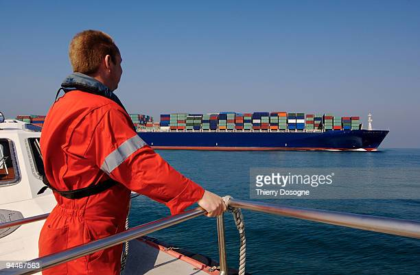 containers ship and pilot