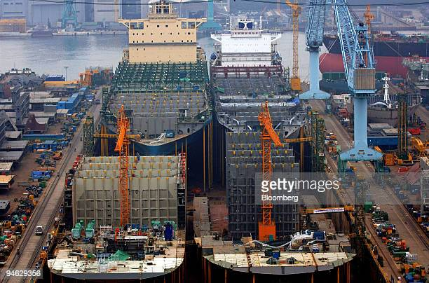 Containers ships are built in a drydock at the Hyundai Heavy Industries Co's shipyard in the port of Ulsan South Korea Friday August 11 2006 Hyundai...