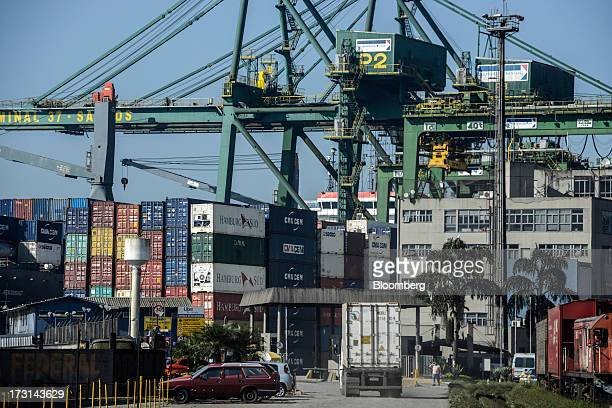 Containers sit inside a terminal at the Port of Santos in Santos Brazil on Friday July 5 2013 Rising borrowing costs and the global bond selloff...