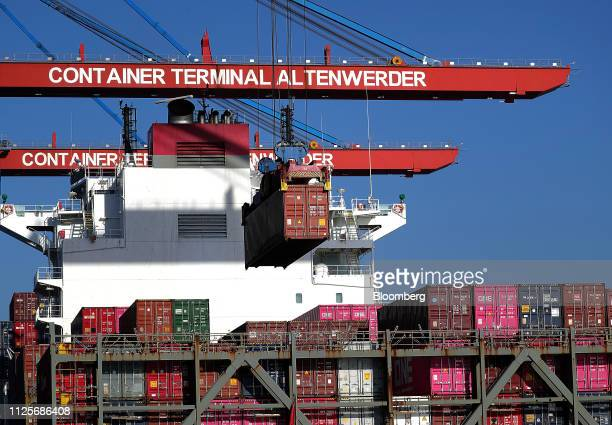 Containers sit on the Budapest Bridge container vessel at the HHLA Container Terminal Altenwerder in the port of Hamburg in Hamburg Germany on Monday...