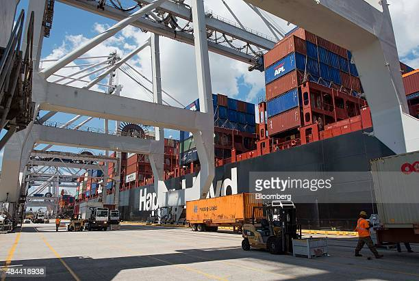 Containers sit on trucks before being loaded onto cargo ships at the Port of Savannah in Savannah Georgia US on Friday Aug 14 2015 The trade deficit...