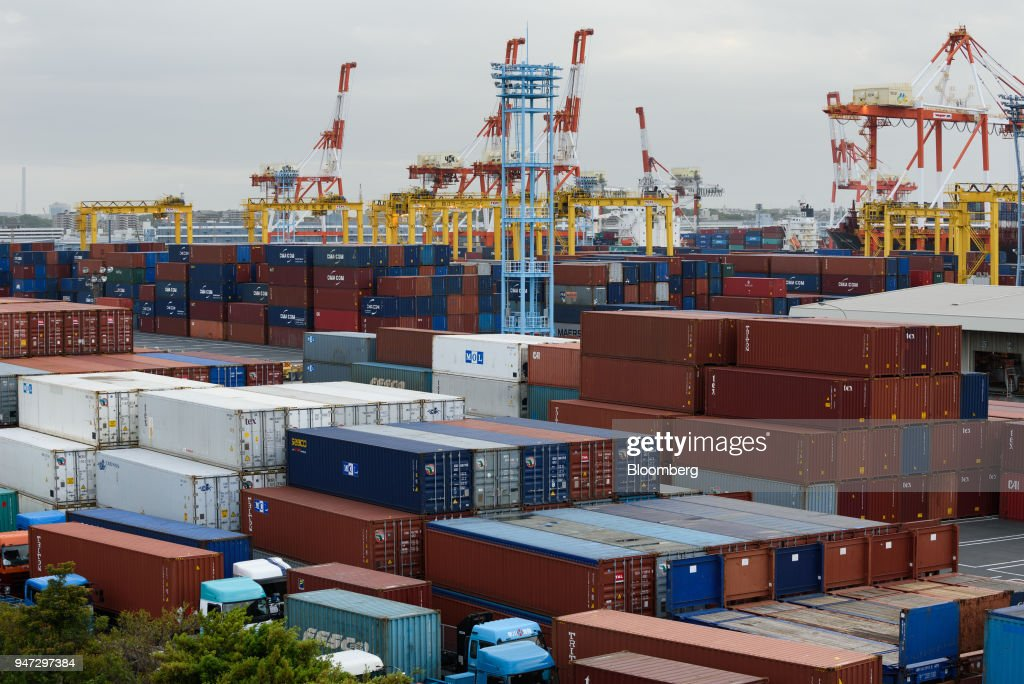 Containers sit stacked at a shipping terminal in Yokohama, Japan, on Monday, April 16, 2018. Japan and China held their first high-level economic dialogue in almost eight years on April 16 against a backdrop of trade threats from the U.S. Photographer: Akio Kon/Bloomberg via Getty Images