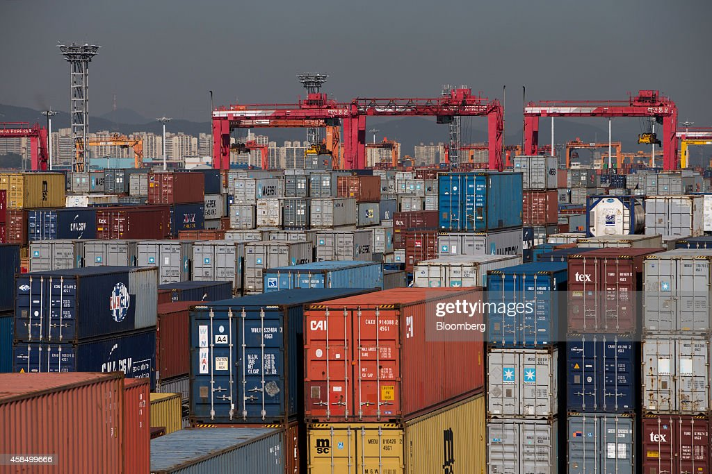 Containers sit stacked at the CJ Korea Express Corp