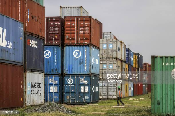 Containers sit stacked in a yard at Krishnapatnam Port in Krishnapatnam Andhra Pradesh India on Friday Aug 11 2017 Growth in gross domestic product...