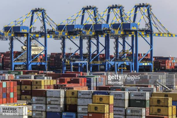 Containers sit stacked next to gantry cranes at Krishnapatnam Port in Krishnapatnam Andhra Pradesh India on Friday Aug 11 2017 Growth in gross...