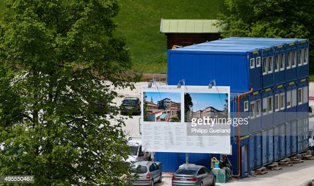 Containers stand next to the construction site of a new wing at Schloss Elmau, a luxury spa hotel, in the Bavarian Alps of southern Germany on June...