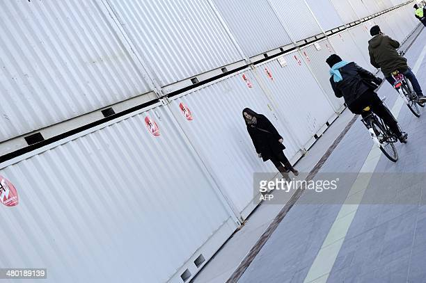 Containers used as shields are being placed at the Museumplein in Amsterdam on March 23, 2014. US president Barack Obama will visit the Rijksmuseum...