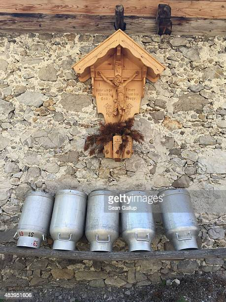 Containers used for transporting milk stand outside an alm a mountain farmer's hut at Gramaialm settlement in the Falzthurntal valley in the...