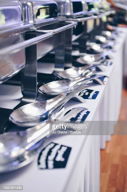 Containers With Spoons Arranged On Table In Ceremony