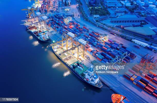 containers yard in port congestion with ship vessels are loading and discharging operations of the transportation in international port.shot from drone. - business finance and industry stock-fotos und bilder