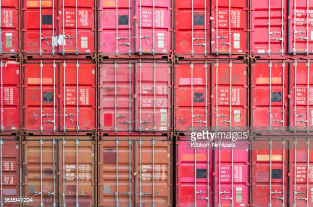 Containers yard in port congestion with ship vessels are loading and discharging operations of the transportation in international port.