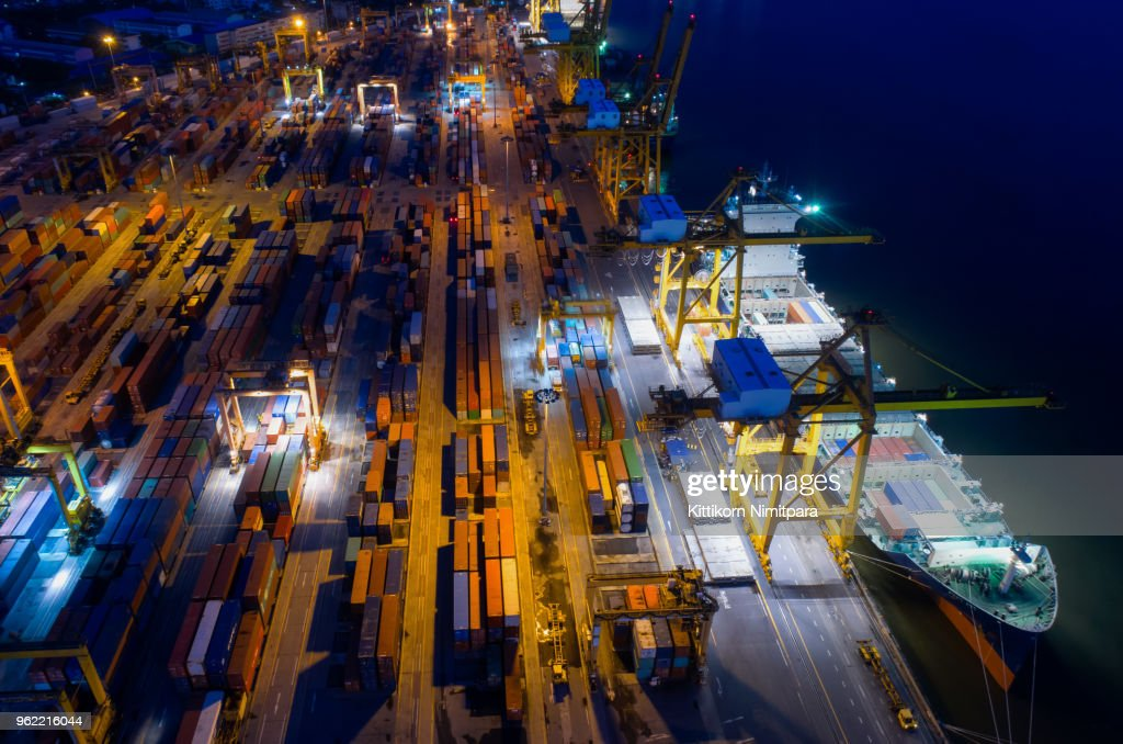 containers yard in port congestion with ship vessels are loading and