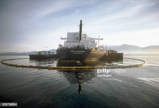 A containment boom attempts to hold oil from a leaking ARCO tanker in the Straits of Juan de Fuca off Port Angeles Washington USA   Location near...