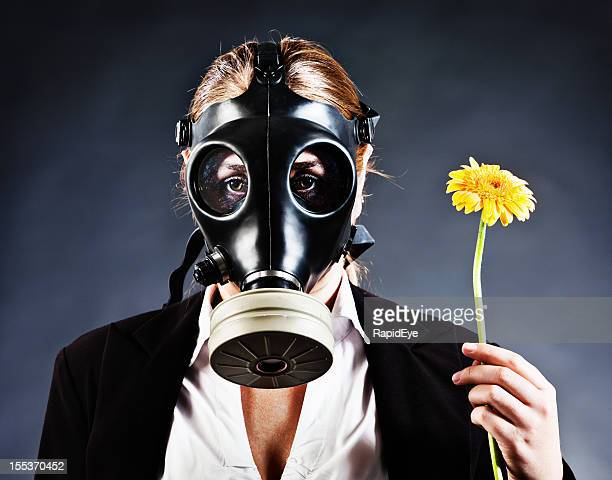 Contamination, pollution or allergies force woman to wear gas mask