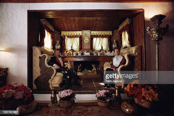 Conte Giovanni NuvolettiPerdomini and his wife Contessa Clara NuvolettiPerdomini pose in the living room of Villa Bella in Cortina d'Ampezzo Italy in...