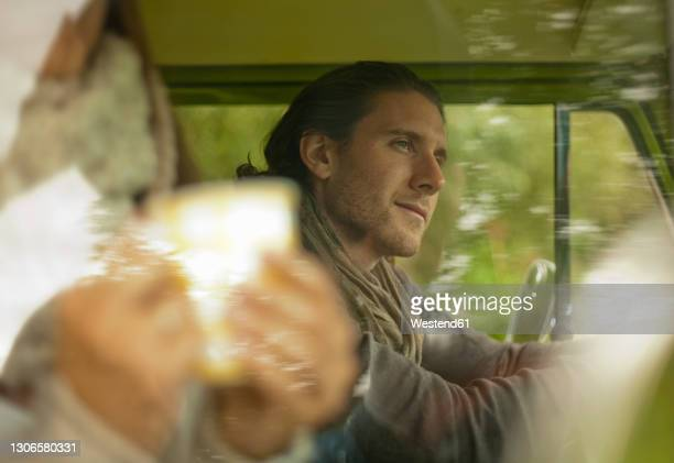 contemplated man in camper van looking away - women wearing see through clothing stock pictures, royalty-free photos & images