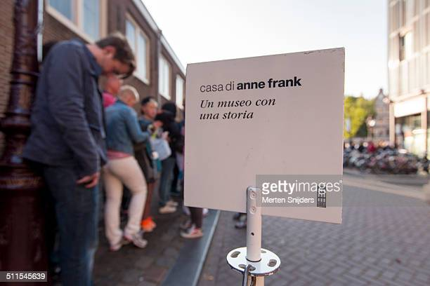 contemplating man outside anne frank house - anne frank house stock pictures, royalty-free photos & images