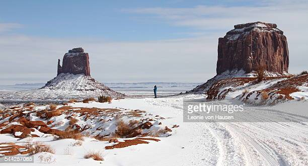 contemplating monument valley in the snow - monument valley tribal park stock photos and pictures