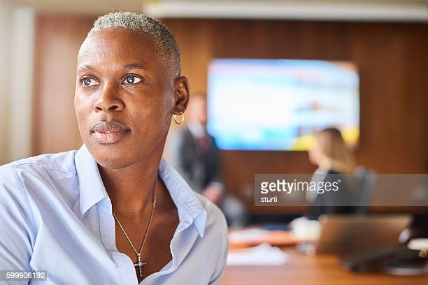 contemplating the companies next move - androgynous stock pictures, royalty-free photos & images