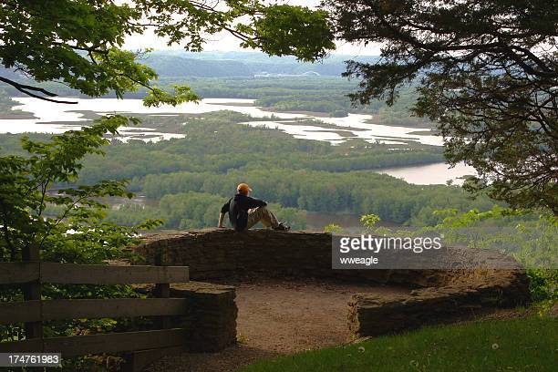 contemplating the view (boy sitting in center) - mississippi river stock pictures, royalty-free photos & images