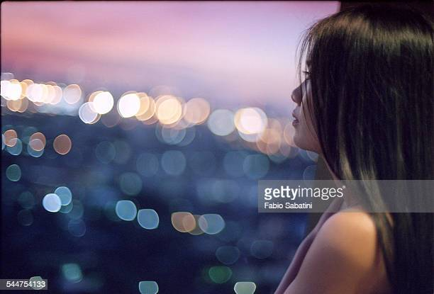 Contemplating Tokyo skyline at sunset
