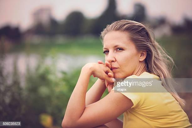 Contemplating woman outdoor portrait