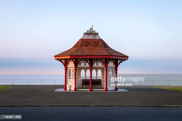 contemplation, bus stop, shelter, cleveland, somerset, england - clevedon pier stock pictures, royalty-free photos & images