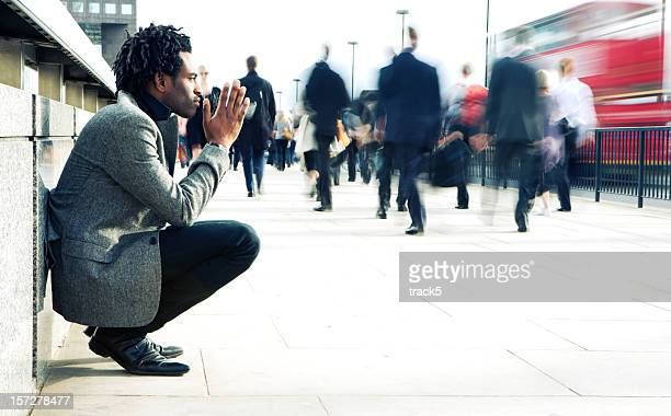 contemplation from a solitary character contrasting against a hurried world - place of worship stock pictures, royalty-free photos & images