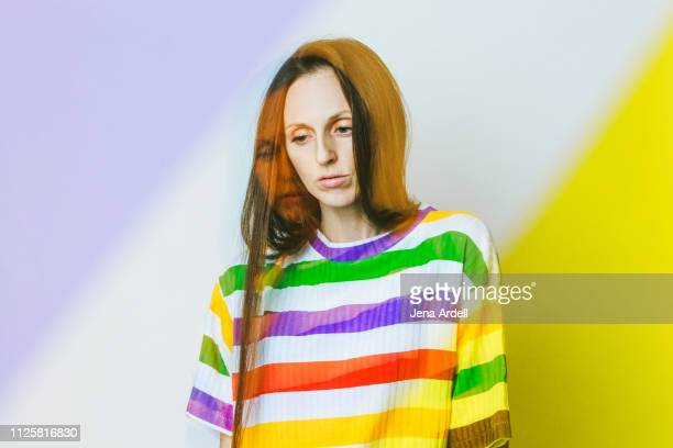 contemplation, woman thinking, woman wearing striped shirt, woman looking away, colorful portrait woman, creativity - selbstporträt stock-fotos und bilder