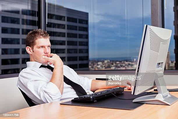 Contemplative Businessman Sitting at Desk